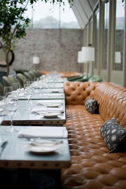 Handsome cognac leather banquet seating at Tavern in Los Angeles BellaRusticaDesign.com