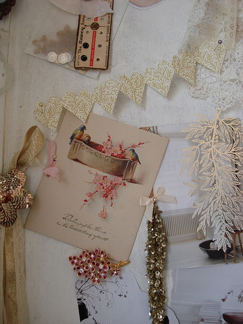 A PIN BOARD WITH LOTS OF LOVELY THINGS