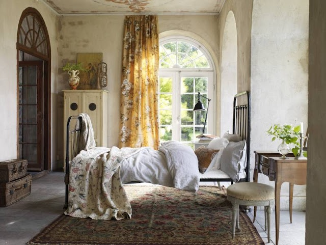 I love the mood created by the colors and fabrics in this room.