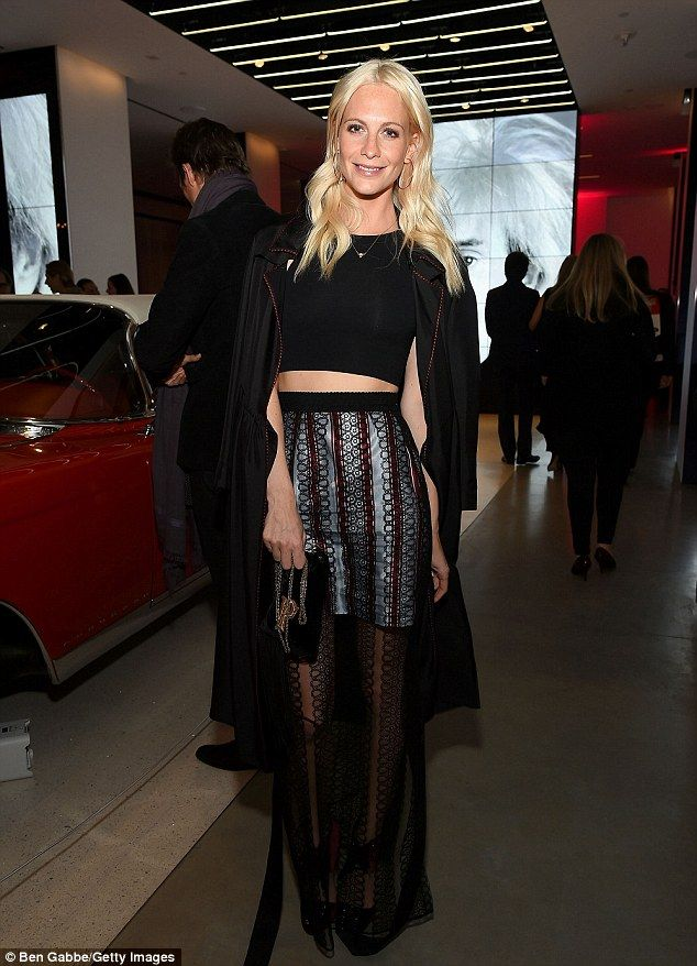 Blonde ambition: And British model Poppy Delevingne - whose sister is Cara - bared her tau...