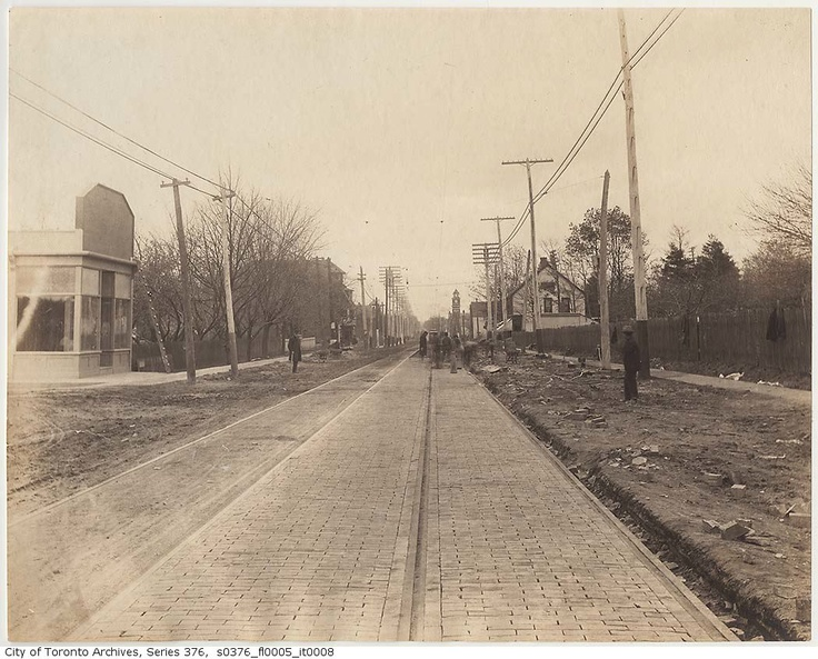 Looking west along Queen Street East in 'The Beach', at Lee Avenue in 1897. The firehall tower at Queen E. and Herbert Ave can be seen in the distance.