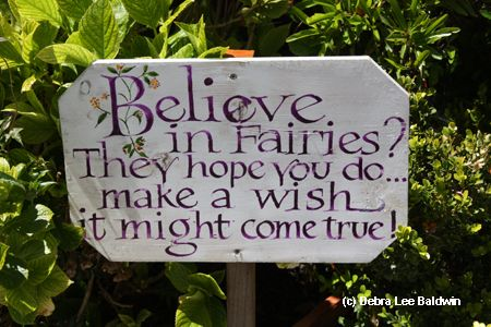 Cute sign!  Next time you're in the garden, close your eyes, breathe deeply and recall your first encounter with fairies.