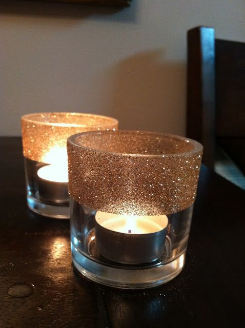 DIY Glitter TeaLight Votive Candle Holders After digging through my craft stash I found what I needed to make votives for my Christmas table: plain glass votives, gold glitter, painters tape, and Elmer's spray glue. http://namesakedesign.blogspot.com/2011/11/table-toppers.html