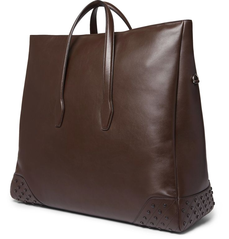 Don't let the elegant design of <a href='http://www.mrporter.com/mens/Designers/Tods'>Tod's</a>' leather holdall fool you; it's a particularly functional option for business trips or weekends away. Crafted in Italy from dark-brown leather, it is set on rubber gommino feet - a trademark of the brand's iconic driving shoes. The large proportions and distinctive shape make it easy to keep tailoring wrinkle-free.