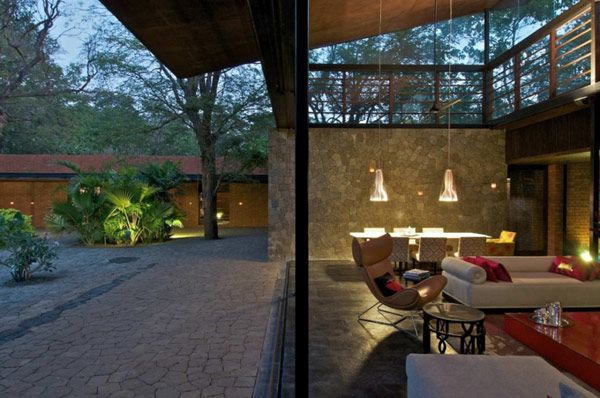 Architecture, Exterior Chandelier White Sofa Table Chair Wooden Ceiling Roof Stone Brick Wall Kiln Homes Forest Interior Chandelier Marble Tile Floor Stone Pattern Pillar Furniture Light: Outstanding, Modern Country Home Near Bombay: Brick Kiln House