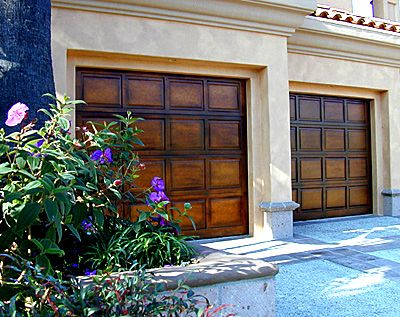 Faux finished metal garage doors to look like wood