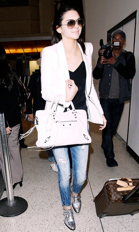 Kendall Jenner chose a playful pair of silver oxfords to pair with her distressed denim // #CelebrityStyle