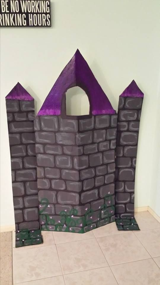 Rapunzel Tower: This was made out of a fridge box and 4 paints (black, white, purple and green).  Mixed to add different colouring.  First I cut the shape, painted all grey.  Then added the black lines for brickwork.  Once dry added dimension by adding lighter grey lining within the bricks.  added the purple tops (playing with colour).  Painted the thorn bush at the bottom.  This is made for my class fairy tale theme.
