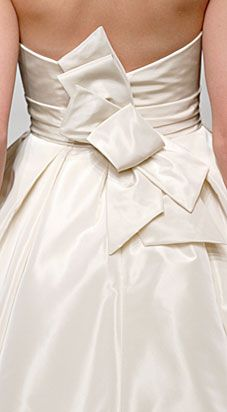 Amsale, Back - Strapless Silk Faille A-Line gown with asymmetrical neckline and bow detail at back.