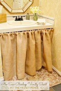 No-Sew Burlap Bathroom Vanity Skirt - But not for my bathroom. Maybe for my computer desk. The drawer was broken and I will love to cover it!