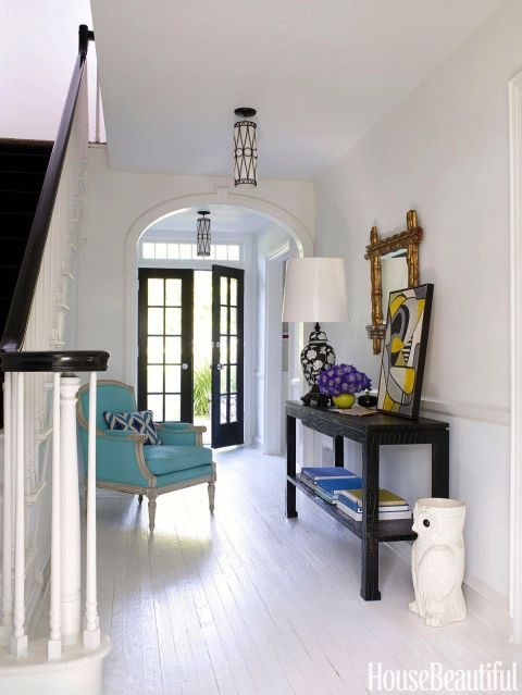 Designer Jonathan Adler wanted the foyer of a Westchester house to have a clean, breezy look. Walls are painted Pocket Watch White by Ralph Lauren; the floor is marine deck paint.