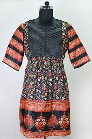 Enrich your wardrobe with this Black Semi Tussar Printed Kurti.  Visit our site www.Harmeendesign.com