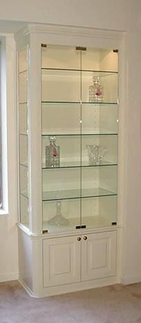 Custom Dining Room Cabinet With Glass Shelves and Doors