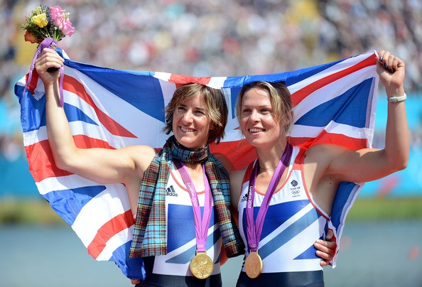Katherine Grainger and Anna Watkins of Great Britain celebrate with their gold medals draped in a Union Jack during the medal ceremony for the Women's Double Sculls final on Day 7 of the London 2012 Olympic Games at Eton Dorney on August 3, 2012 in Windsor, England.