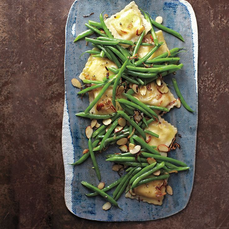 In this take on the green-bean casserole, cheese ravioli replaces the heavy mushroom soup, while sauteed shallots and crunchy toasted almonds stand in for the fried onions.