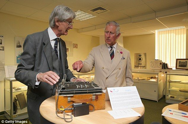 Let's get cracking: Former GCHQ historian Mike gives Prince Charles a demonstration of the...