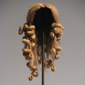 """Victorian Doll Wig. Flax and hand stitched cloth. new tall museum stand, 49"""" overall height. English circa 1890"""