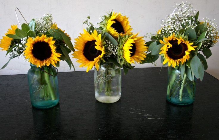 Sunflower centerpieces in mason jars rehearsal dinner