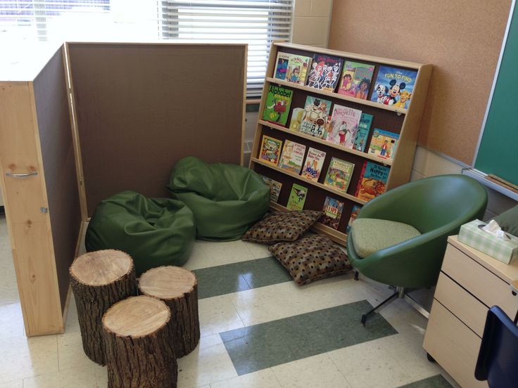 Reading area with stump stools, acoustic dividers, bean bags, and retro chair