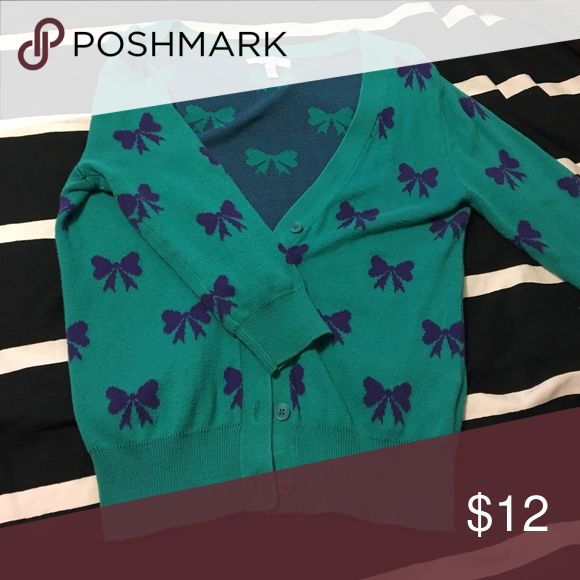 Delia's Bow Cardigan Like new teal cardigan with purple bows. The color combination is beautiful! 3/4 sleeves. Sweaters Cardigans