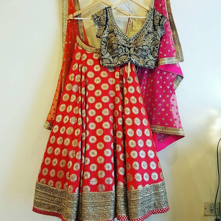 Beautiful red color bridal lehenga and blue color designer blouse with hand embroidery zardosi work. 12 August 2017