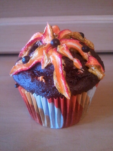 Multi-colored frosting, cream filled volcano cupcake