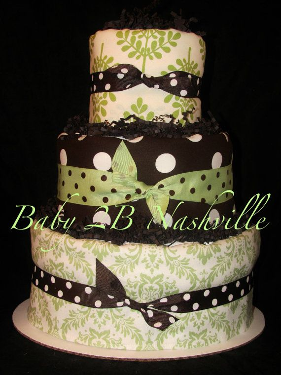 If your style is elegant and sofisticated then you have found the right cake for you! This listing is for a 3 tier cake done in brown and light green fabric decorated burps. Your cake will come in a clear cello bag topped with a gorgeous big bow. Ready for gifting! We have been making diaper cakes since 2007. You will love this cake!  #timelesstreasure