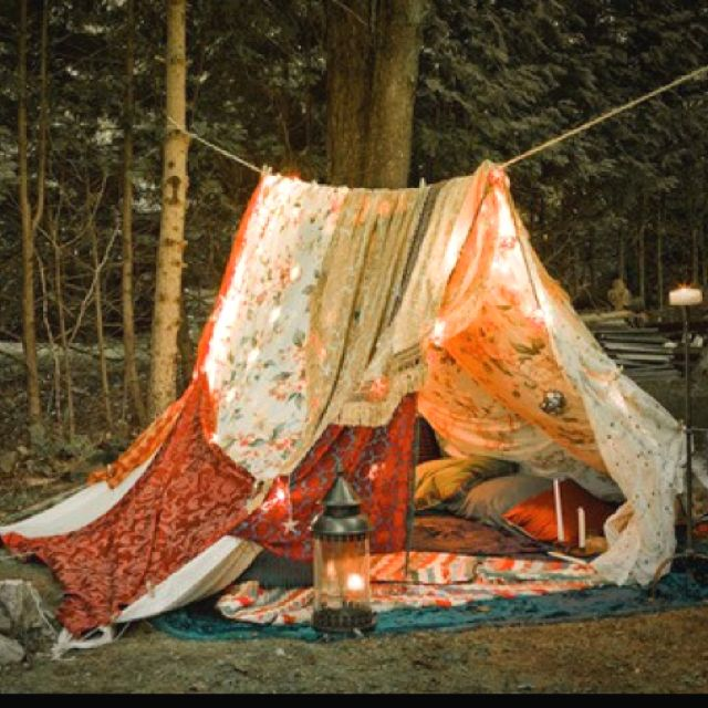 Sew two sheets with different patterns together, then tie a rope between two trees and put sheets over rope. A place to relax away from it all.
