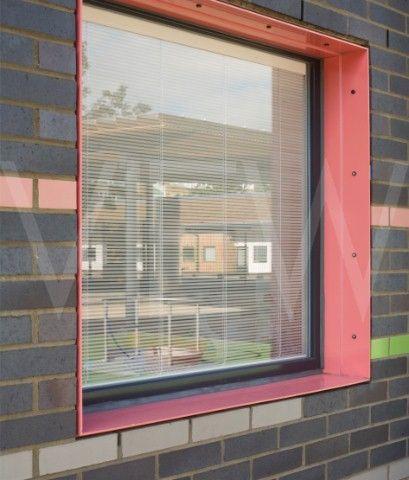 Tuke School Haverstock Associates London 2010 Detail of coloured window reveal and brick facade