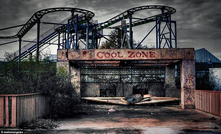 This eerie photograph shows a corroded rollercoaster soaring into the sky behind a graffiti-covered ride at the abandoned Six Flags theme park, New Orleans <<< repinned by www.BlickeDeeler.de