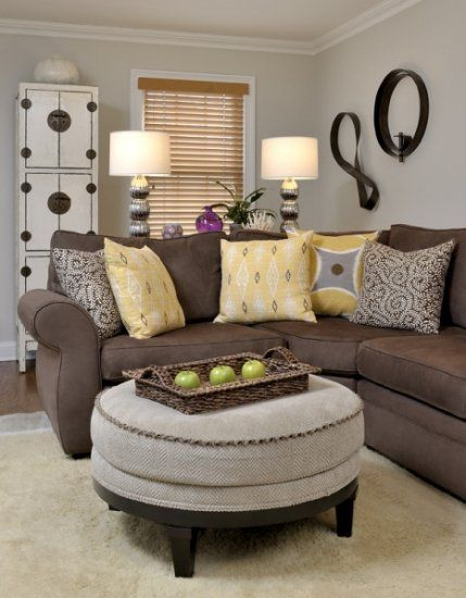 Family Room: Love the ottoman with a tray as a coffe table, and the pops of color.
