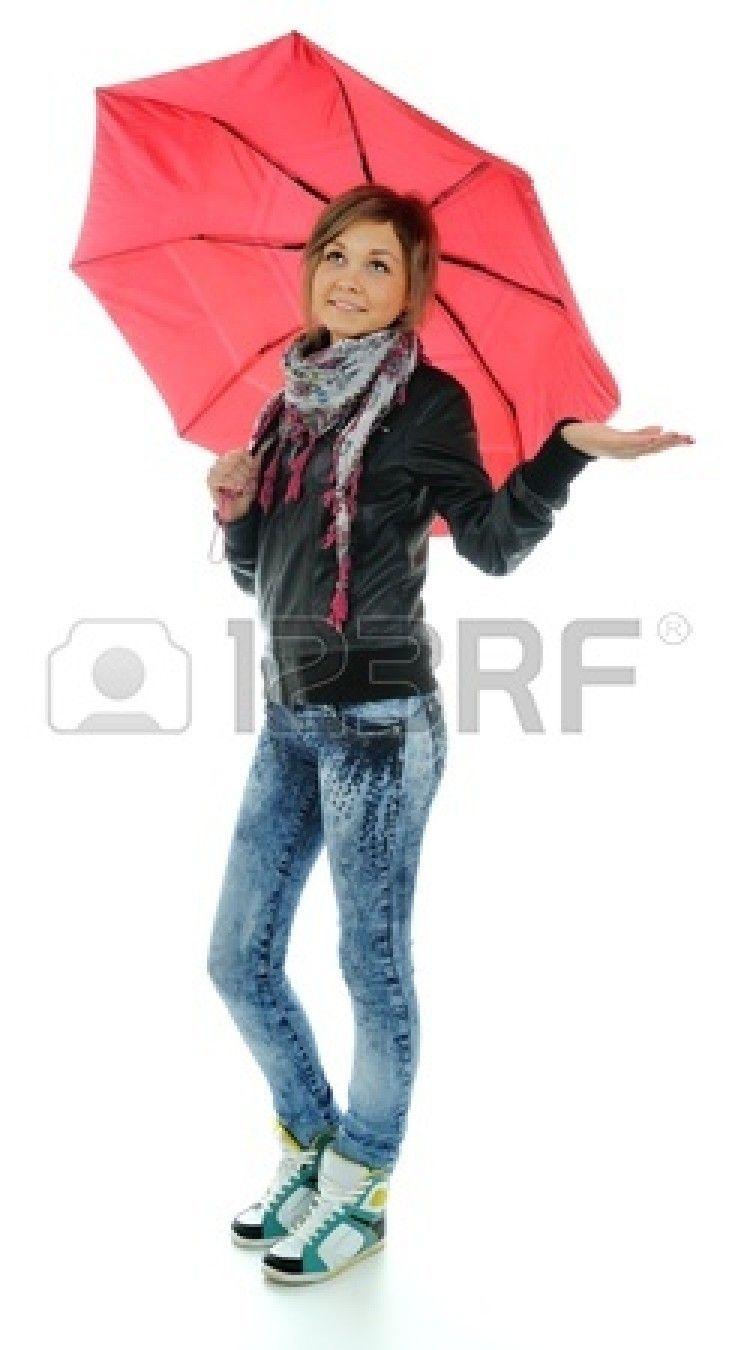 La chica con el paraguas rojo sobre el fondo blanco Foto de archivo