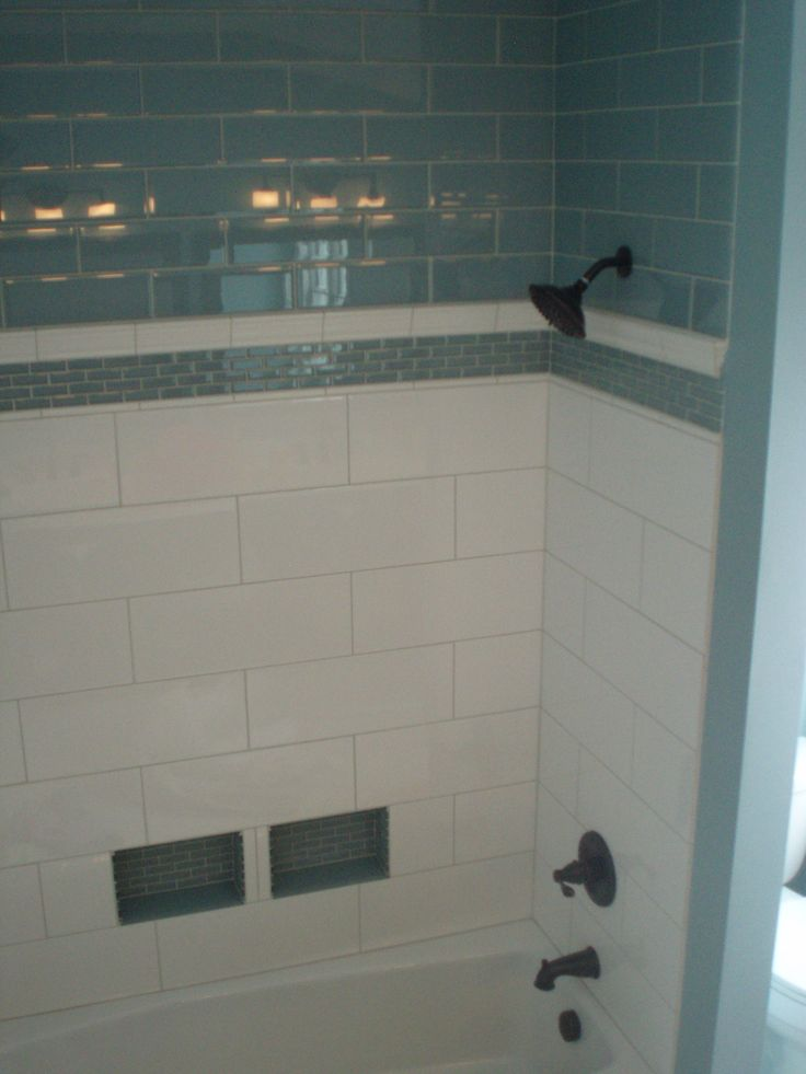 Porcelain And Glass Subway Tile Are Classic The Oversized Tiles Minimize Grout Lines To Make