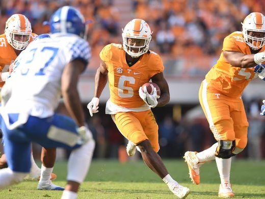 Tennessee running back Alvin Kamara carries the ball