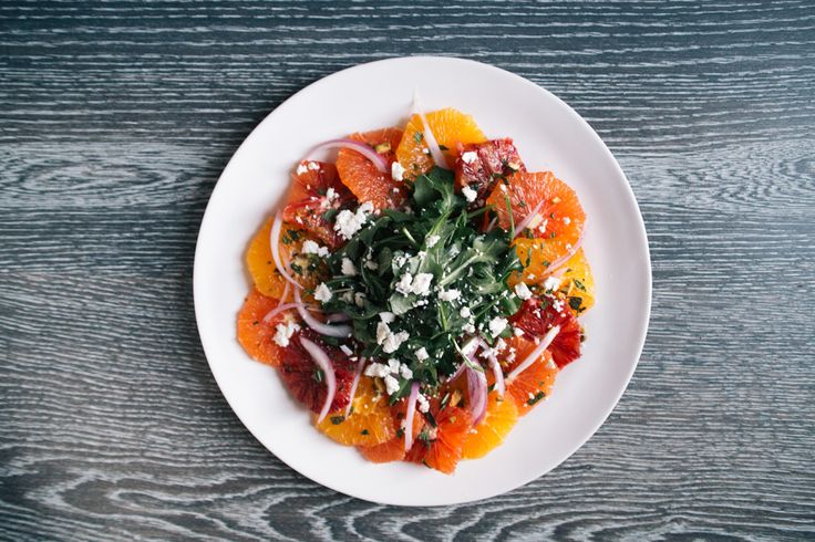 Citrus-Salad with Navel, Cara Cara, and blood oranges on a white balsamic vinaigrette with arugula and mint.