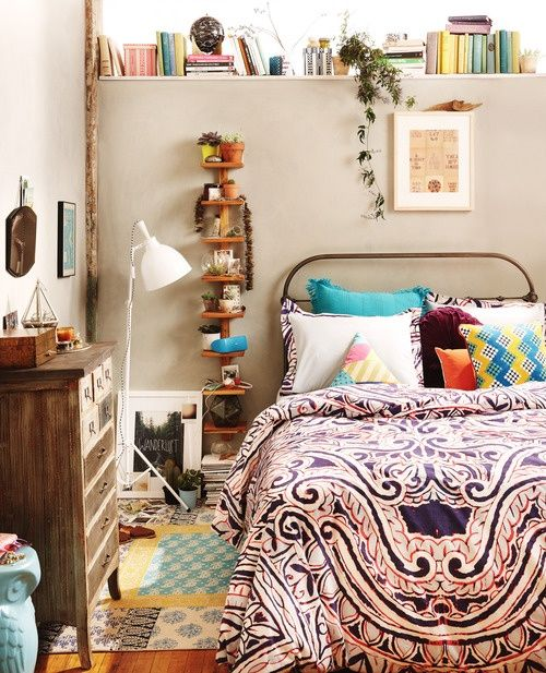 This is a very comfortable bedroom. Decorated in a fun, easygoing way... & books within reach!