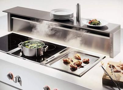 Perfect for a big island for keeping little fingers away from the cook top, provide ventilation without something big and bulky and provide a little shelf for a place to put things! Gaggenau's AT 400 Backsplash Ventilation freestanding unit