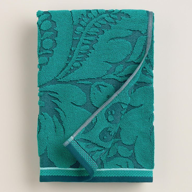 This vibrant teal bath towel is defined by a bold motif with a unique, raised texture. Complete your set with our matching hand towel.