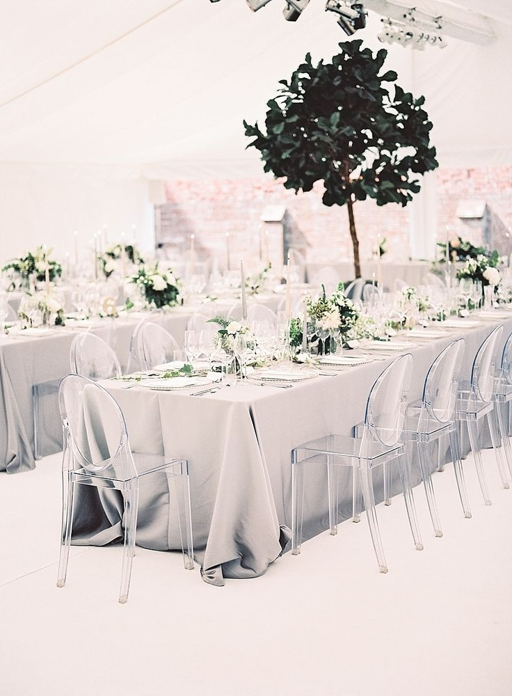 Gray, modern wedding reception tables. Photography : Katie Julia Read More on SMP: http://www.stylemepretty.com/2016/08/11/modern-white-grey-english-tent-wedding/