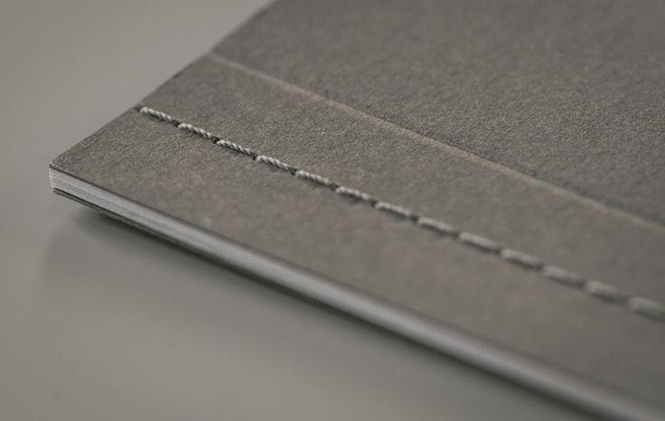 Singer side sewn book / Dust side sewn / grey thread / 270gsm Cairn dark grey / scored