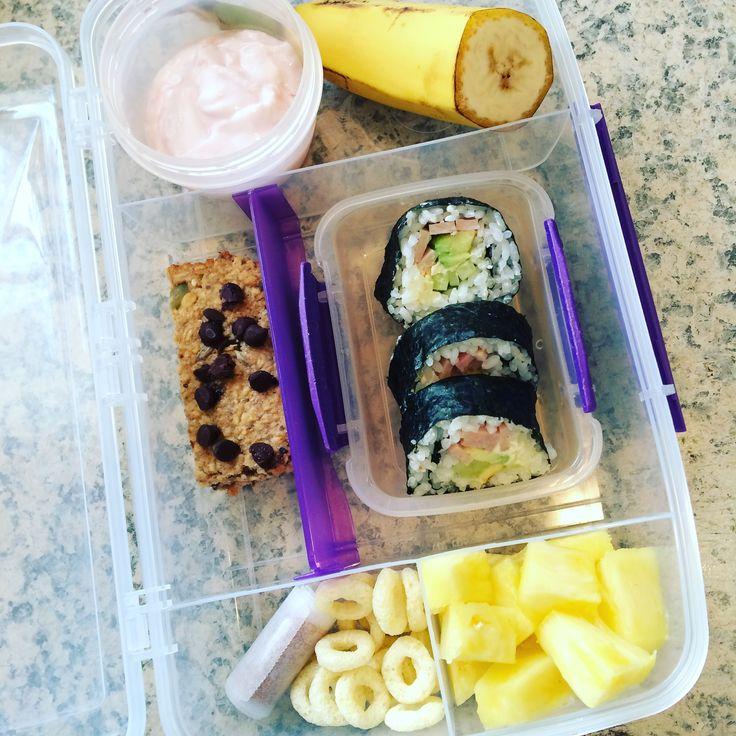 Lunch box idea : Banana  Strawberry yoghurt  Homemade Muesli bar  Pear and berry roll up  Banana puff rings  Pineapple  Sushi