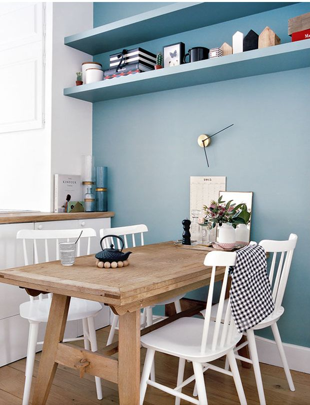 small light-wood farm table + white chairs