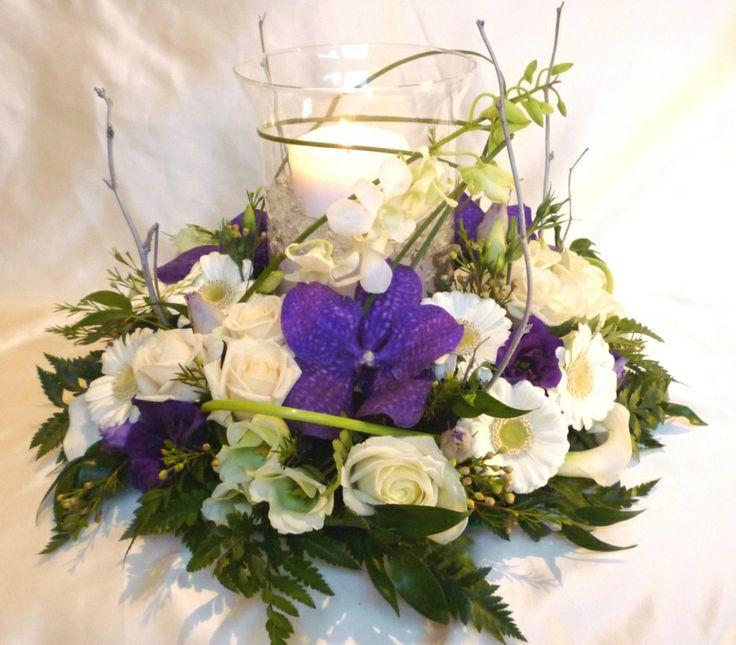 Purple and cream hurricane vase flowers xxx