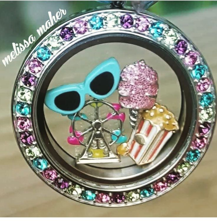 Love this locket with our multi colored face and summer charms.