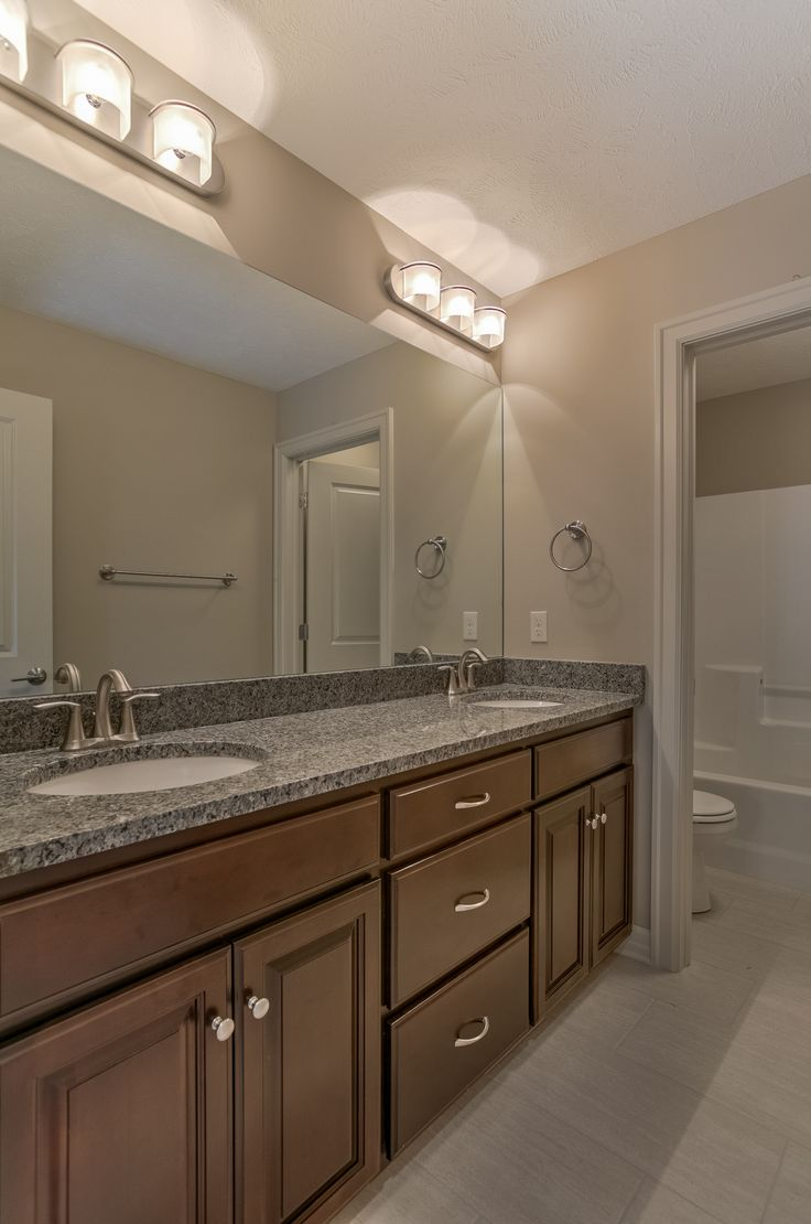 Bathroom with double sinks custom jackson 2 story for Master bathroom jack and jill