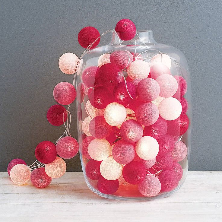Pick your own colour cotton ball lights - white, yellows and orange. Perhaps displayed in large vase, or hung vertically?