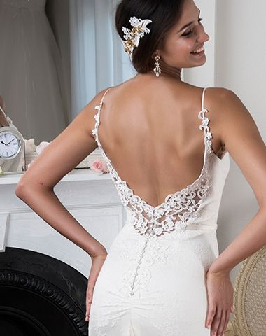 Bridal gown and accessories by Peter Trends Bridal.