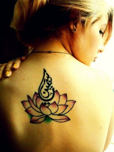 back #tattoo lotus and Arabic calligraphy