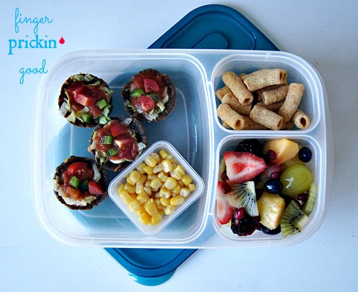 Here's what's inside: MOMables Black Bean Taco Cups= 20 carbs Fresh Fruit (strawberries, grapes, peaches, pineapple, blackberries, blueberries, pomegranate arils & kiwi)= 16 carbs LesserEvil Super Bites Cheesy Nacho (made with white bean, brown rice, quinoa, lentil & chai)= 9 carbs Chobani Yogurt Tube (not pictured)= 7 carbs Corn= 4 carbs Lunch Total= 56 carbohydrates
