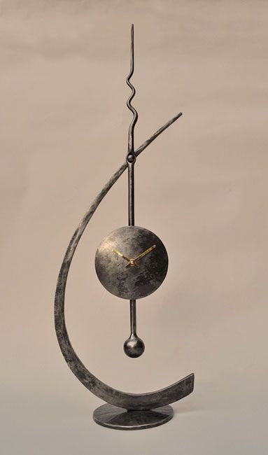 """Swinging Clock"" 675mm high Suitable for table, sideboard or mantelpiece"